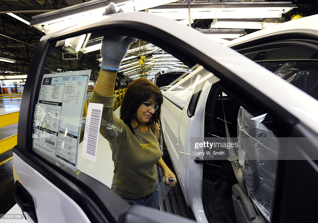 Janna Dake, a Ford inspector for 20 years, works the final assembly line for the F-150 pickup at the Kansas City Ford Assembly plant October 2, 2008 in Claycomo, Missouri. Ford's Kansas City Assembly plant celebrates production of the new 2009 Ford F-150 with the official roll out.