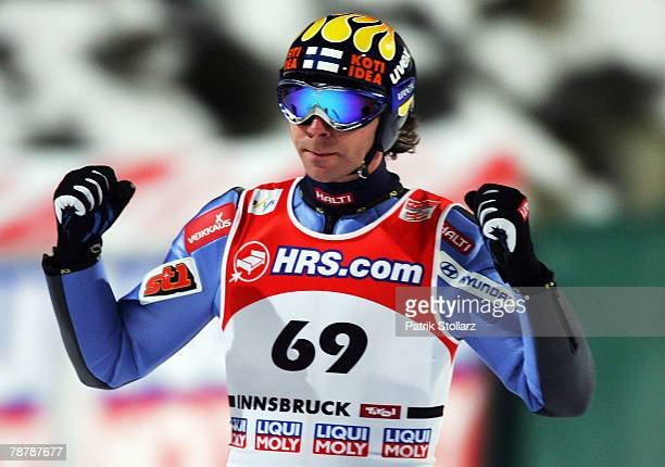 Janne Ahone celebrates after winning the third round of the FIS Ski Jumping World Cup event at the 56th Four Hills Ski Jumping Tournament on January...