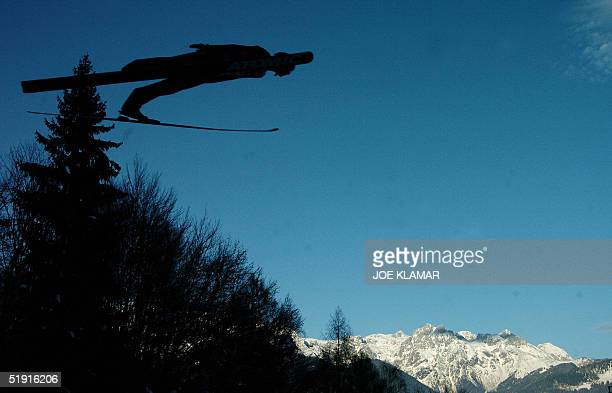 Janne Ahonen of Finland is seen silhouetted as he makes a practice jump prior to the ''Four Hills competition'' of the SkiJumping World Cup in...