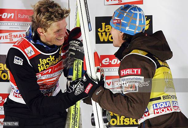 Janne Ahonen of Finnland and Thomas Morgenstern of Austria celebrate during the fourth round of the FIS Ski Jumping World Cup event at the 56th Four...