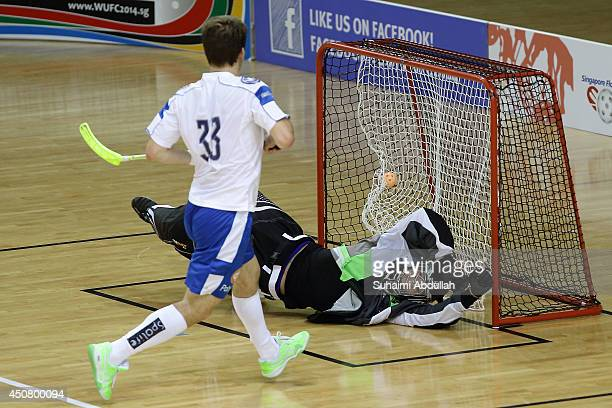 Janne Hoikkanen of Finland scores during the World University Championship Floorball match between Japan and Finland at the Sports Hub OCBC Arena on...