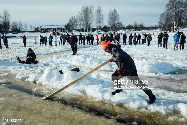 Janne Käpylehto tries to initiate the rotation of an ice carousel, under construction for a world record attempt on a frozen lake in Lappajärvi,...