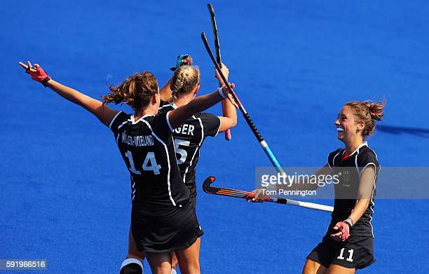 Janne MullerWieland of Germany Hannah Kruger of Germany and Lisa Schutze of Germany celebrate after Germany defeated New Zealand 21 in the Women's...