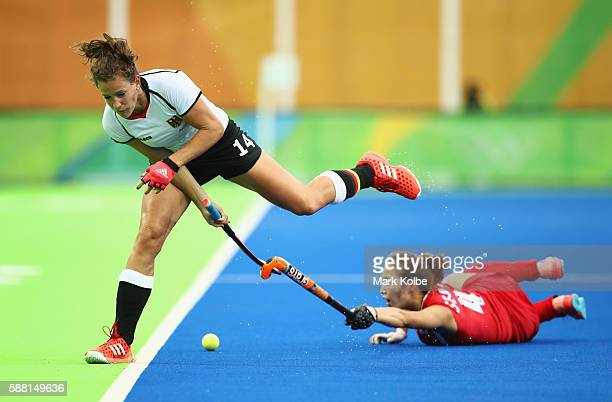 Janne MullerWieland of Germany is challenged by Jungeun Seo of Korea during the Women's Pool B Match between Germany and Korea on Day 5 of the Rio...