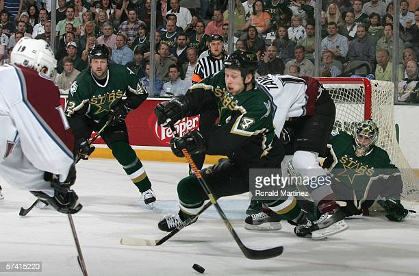 Janne Niinimaa of the Dallas Stars makes a diving stab at the puck during Game two of the NHL Western Conference Quarterfinals against the Colorado...