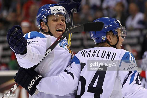 Janne Niskala of Finland celebrate with his team mates after he scores his team's equalizing goal during the IIHF World Championship qualification...