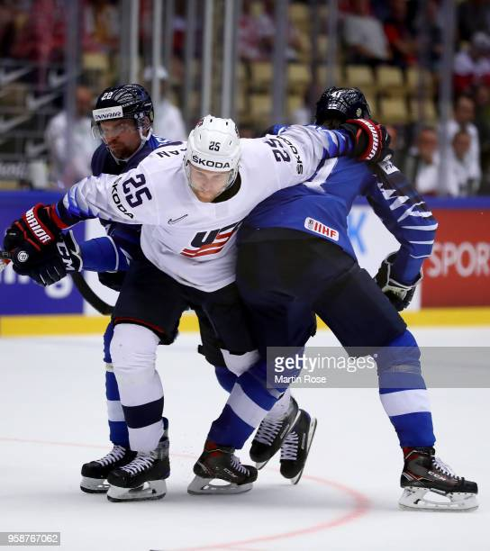 Janne Pesonen of Finland and Blake Coleman of the United States battle for the puck during the 2018 IIHF Ice Hockey World Championship Group B game...