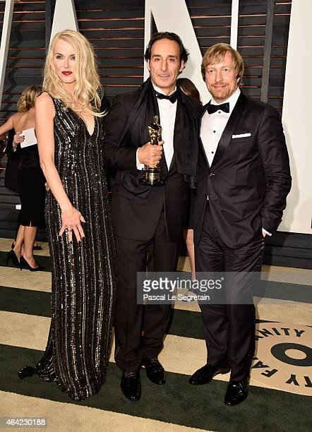 Janne Tyldum composer Alexandre Desplat and director Morten Tyldum attend the 2015 Vanity Fair Oscar Party hosted by Graydon Carter at Wallis...