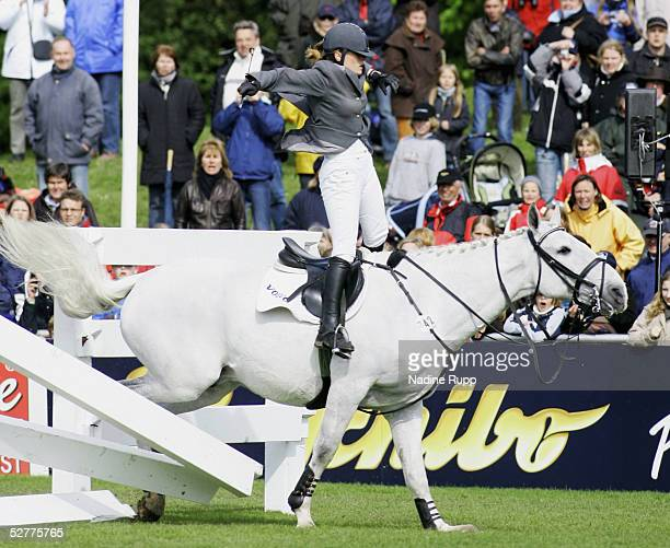 Janne-Friederike Meryer of Germany on her horse Callistro falls at the Tschibo Wall during the 76. German Jumping-Derby 2005 of the German Jumping...
