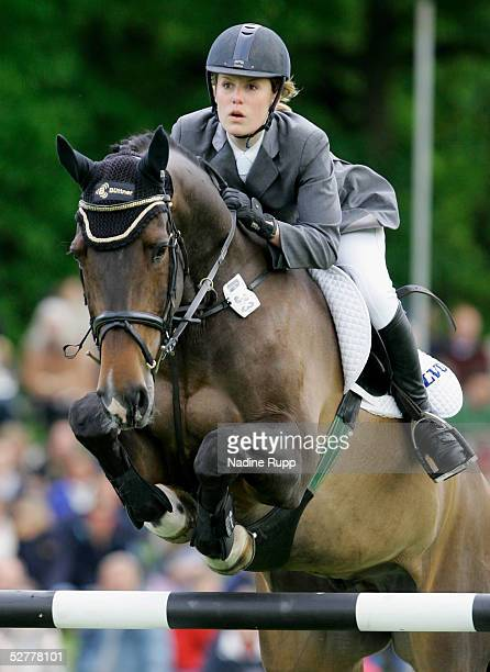 Janne-Friederike Meyer of Germany jumps on her horse Calandro during the Hasseroeder championship of Hamburg of the German Jumping and Dressage Grand...