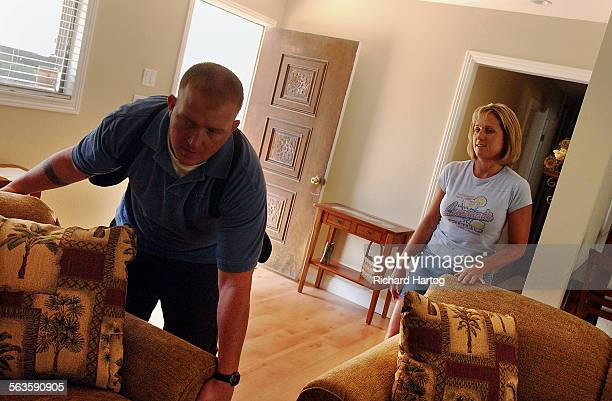 Janneil Brown looks on as Chris West hauls in a new sofa Saturday morning in Redlands Janneil and her husband Steve recently bought a house in...
