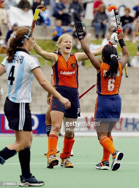 Janneke Schopman of Netherlands celebrates with temmate Maartje Scheepstra as Argentina's Maria Paz Ferrari looks dejected after their Womens'...