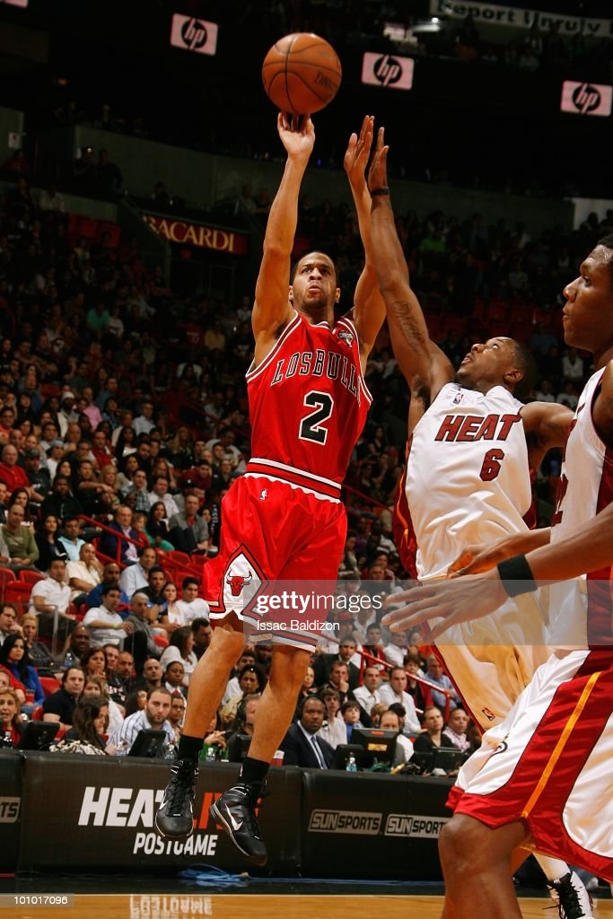 Jannero Pargo #2 of the Chicago Bulls takes a jump shot against Mario Chalmers #6 of the Miami Heat during the game on March 12, 2010 at American Airlines Arena in Miami, Florida. The Heat won 108-95.