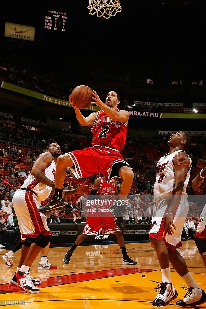 Jannero Pargo #2 of the Chicago Bulls takes the ball to the basket against Mario Chalmers #6 of the Miami Heat during the game on March 12, 2010 at American Airlines Arena in Miami, Florida. The Heat won 108-95.