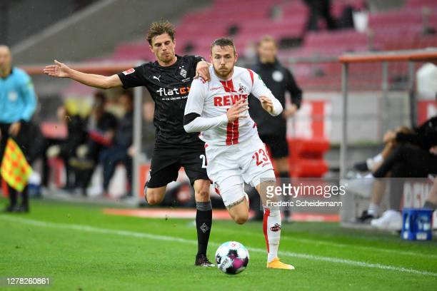 Jannes Horn of 1 FC Koln battles for possession with Tobias Sippel of Borussia Monchengladbach during the Bundesliga match between 1 FC Koeln and...