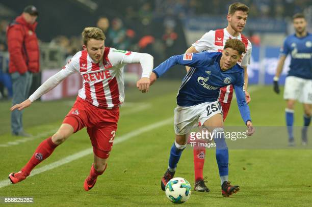 Jannes Horn of Koeln and Amine Harit of Schalke battle for the ball during the Bundesliga match between FC Schalke 04 and 1 FC Koeln Bundesliga at...