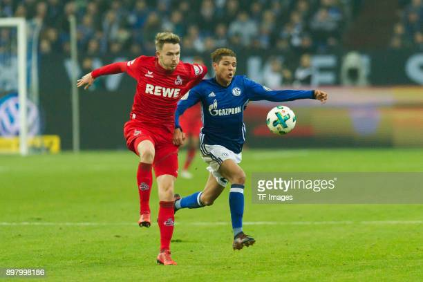 Jannes Horn of Koeln and Amine Harit of Schalke battle for the ball during the DFB Cup match between FC Schalke 04 and 1 FC Koeln at VeltinsArena on...