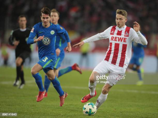Jannes Horn of Koeln and Paul Verhaegh of Wolfsburg battle for the ball during the Bundesliga match between 1 FC Koeln and VfL Wolfsburg at...