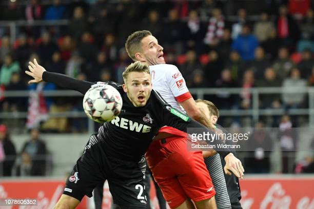 Jannes Horn of Koeln jumps for the ball with Marco Gruettner of Regensburg during the Second Bundesliga match between SSV Jahn Regensburg and 1. FC...