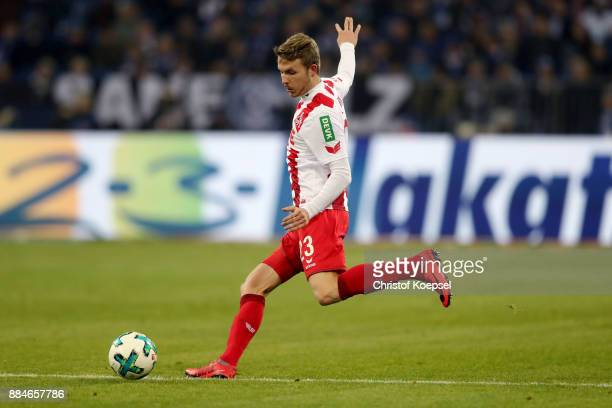 Jannes Horn of Koeln runs with the ball during the Bundesliga match between FC Schalke 04 and 1 FC Koeln at VeltinsArena on December 2 2017 in...