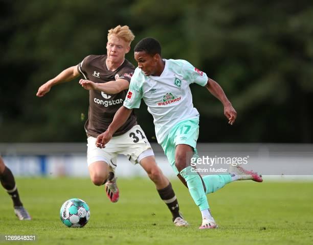 Jannes Wieckhoff of FC St. Pauli and Felix Agu of Werder Bremen battle for the ball during the pre-season friendly match between SV Werder Bremen and...