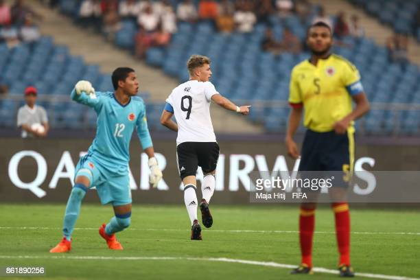 JannFiete Arp celebrates after scoring his team's first goal to make it 01 during the FIFA U17 World Cup India 2017 Round of 16 match between...