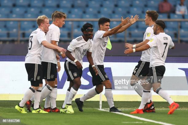 JannFiete Arp celebrates with his teammates after scoring his team's first goal to make it 01 during the FIFA U17 World Cup India 2017 Round of 16...