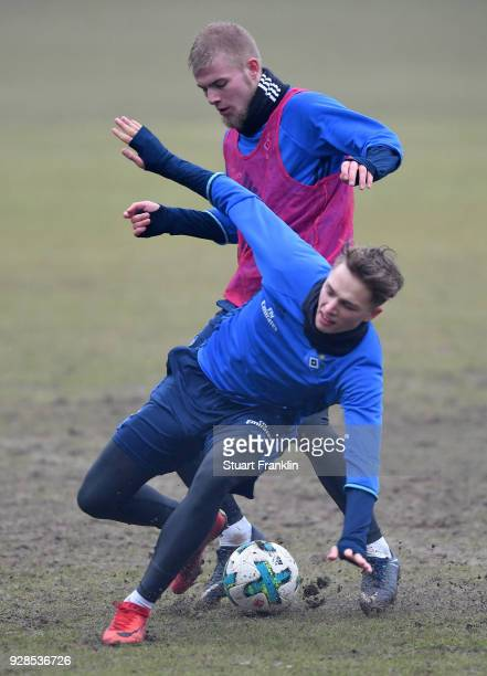 JannFiete Arp is challenged by Rick Van Drongelen of Hamburg during a training session of Hamburger SV at Volksparkstadion on March 7 2018 in Hamburg...