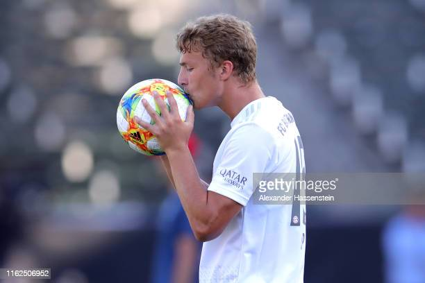JannFiete Arp of FC Bayern Muenchen kisses the match ball during a FC Bayern Muenchen training session at Dignity Health Sports Park on the second...