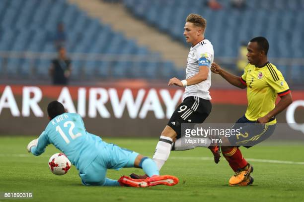 JannFiete Arp of Germany Andres Cifuentes of Colombia and Kevin Mier of Colombia battle for the ball during the FIFA U17 World Cup India 2017 Round...