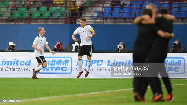 JannFiete Arp of Germany celebrates after scoring during the FIFA U17 World Cup India 2017 group C match between Guinea and Germany at Jawaharlal...