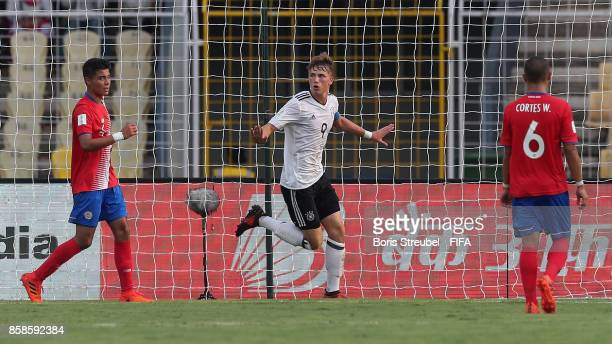 JannFiete Arp of Germany celebrates after scoring his team's first goal during the FIFA U17 World Cup India 2017 group C match between Germany and...