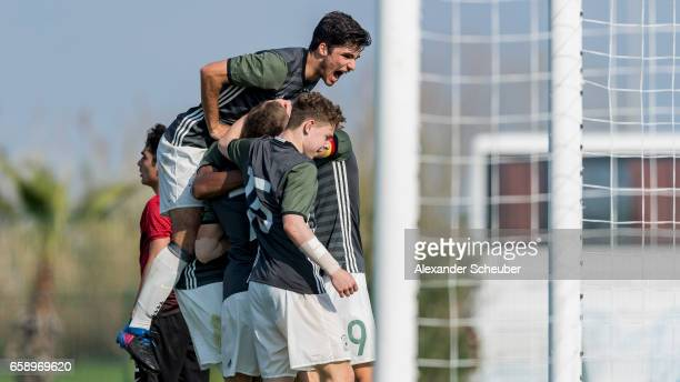 JannFiete Arp of Germany celebrates the second goal for his team with his teammates during the UEFA U17 elite round match between Germany and Turkey...