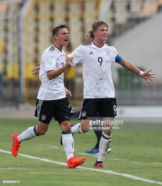 JannFiete Arp of Germany celebrates with team mate Alexander Nitzl after scoring his team's first goal during the FIFA U17 World Cup India 2017 group...