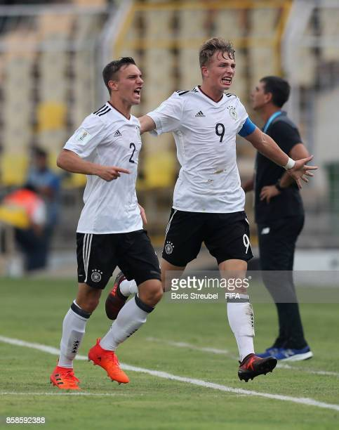 JannFiete Arp of Germany celebrates with team mates after scoring his team's first goal during the FIFA U17 World Cup India 2017 group C match...