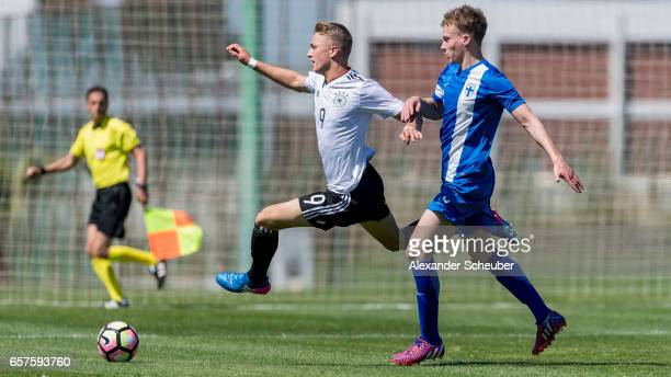 JannFiete Arp of Germany challenges Jasper Tommila of Finland during the UEFA U17 elite round match between Germany and Finland on March 25 2017 in...