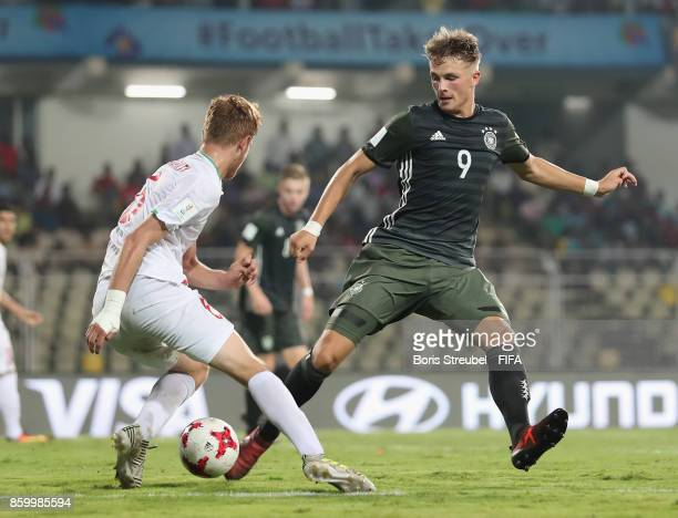 JannFiete Arp of Germany is challenged by Taha Shariati of Iran during the FIFA U17 World Cup India 2017 group C match between Iran and Germany at...