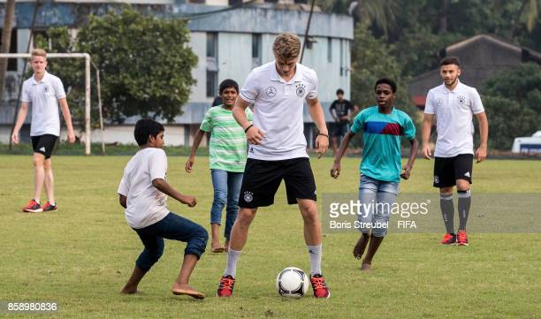 JannFiete Arp of Germany plays football with kids of the orphanage as the team of Germany visit the Agnel Technical Education Complex during the FIFA...