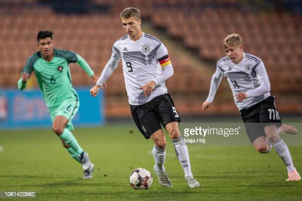 JannFiete Arp of Germany runs with the ball during the Germany U19 against Portugal U19 match of UEFA Four Nations Tournament on November 14 2018 in...