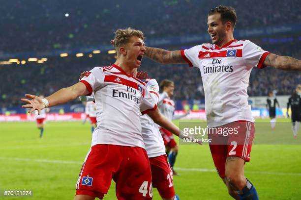 JannFiete Arp of Hamburg celebrates with Dennis Diekmeier of Hamburg after he scored a goal to make it 31 during the Bundesliga match between...