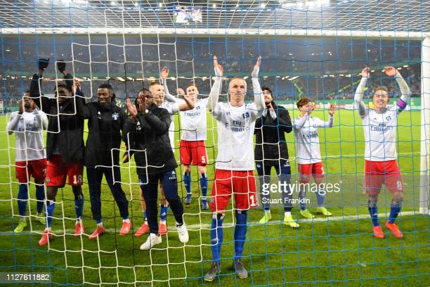 JannFiete Arp of Hamburg celebrates with team mates during the DFB Cup match between Hamburger SV and 1 FC Nuernberg at Volksparkstadion on February...