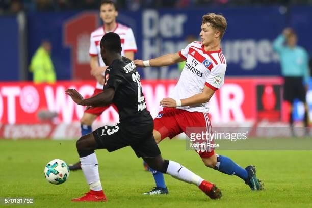 JannFiete Arp of Hamburg fights for the ball with Orel Mangala of Stuttgart during the Bundesliga match between Hamburger SV and VfB Stuttgart at...