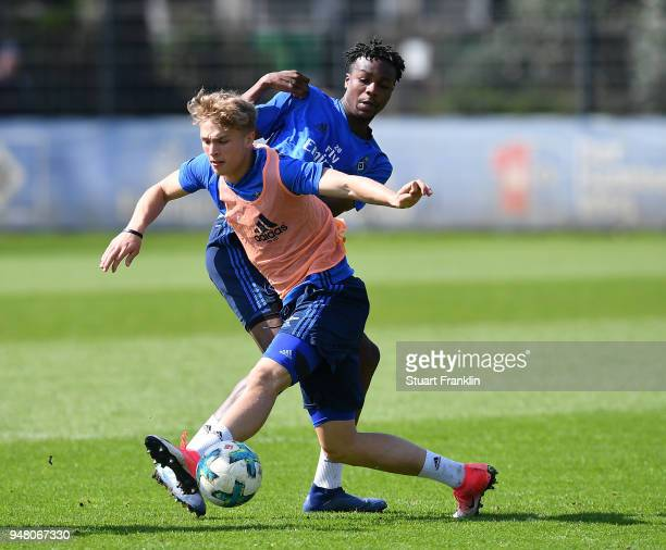 JannFiete Arp of Hamburg in action with Gideon Jung during a training session of Hamburger SV at Volksparkstadion on April 18 2018 in Hamburg Germany