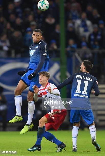JannFiete Arp of Hamburg is challenged by Kevin Akpoguma and Florian Grillitsch of Hoffenheim during the Bundesliga match between Hamburger SV and...