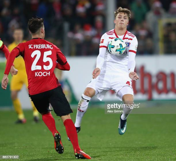JannFiete Arp of Hamburg is challenged by Robin Koch of Freiburg during the Bundesliga match between SportClub Freiburg and Hamburger SV at...