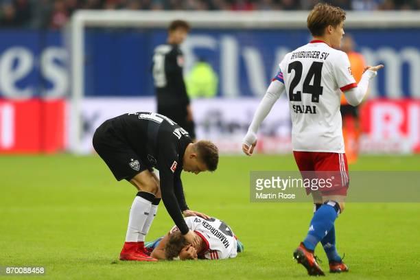 JannFiete Arp of Hamburg lies on the pitch injured during the Bundesliga match between Hamburger SV and VfB Stuttgart at Volksparkstadion on November...