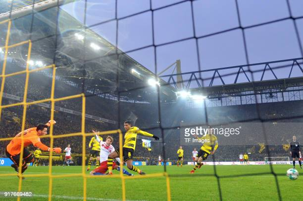 JannFiete Arp of Hamburg Roman Buerki of Dortmund and Manuel Akanji of Dortmund attle for the ball during the Bundesliga match between Borussia...