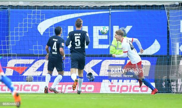 JannFiete Arp of Hamburger SV celebrates after scoring the 10 next to Karim Rekik and Niklas Stark of Hertha BSC during the Bundesliga game between...