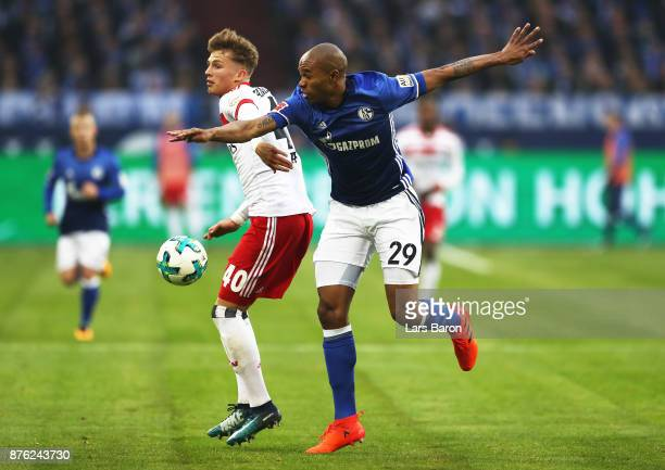 JannFiete Arp of Hamburger SV is challenged by Naldo of Schalke 04 during the Bundesliga match between FC Schalke 04 and Hamburger SV at VeltinsArena...