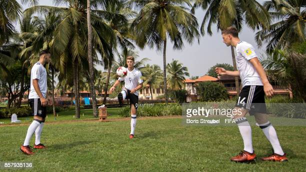 JannFiete Arp Shaverdi Cetin and Yannik Keitel of Germany juggle the ball ahead of the FIFA U17 World Cup India 2017 tournament at Park Hyatt Goa...